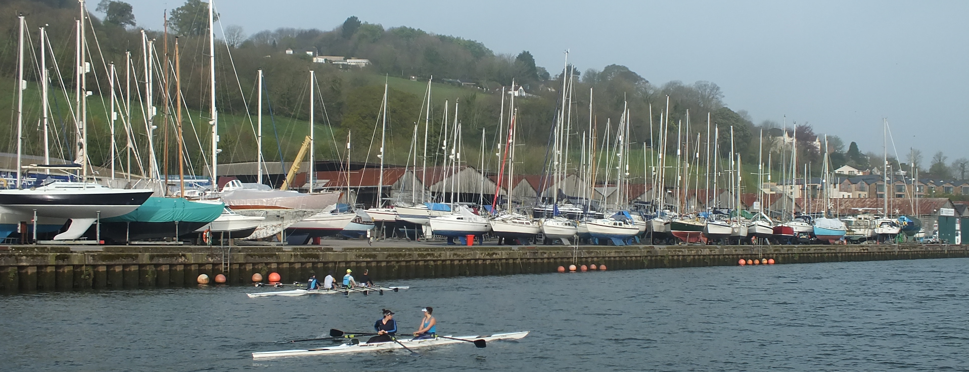 Long view of Baltic Wharf with boats along the river Dart